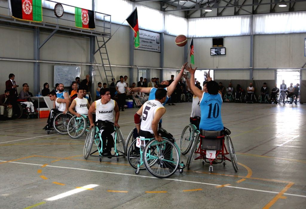 KABUL, Oct. 29, 2016 - Afghan disabled players compete during a national wheelchair basketball tournament between Herat and Kandahar provinces in Kabul, capital of Afghanistan, Oct. 29, 2016. A ...