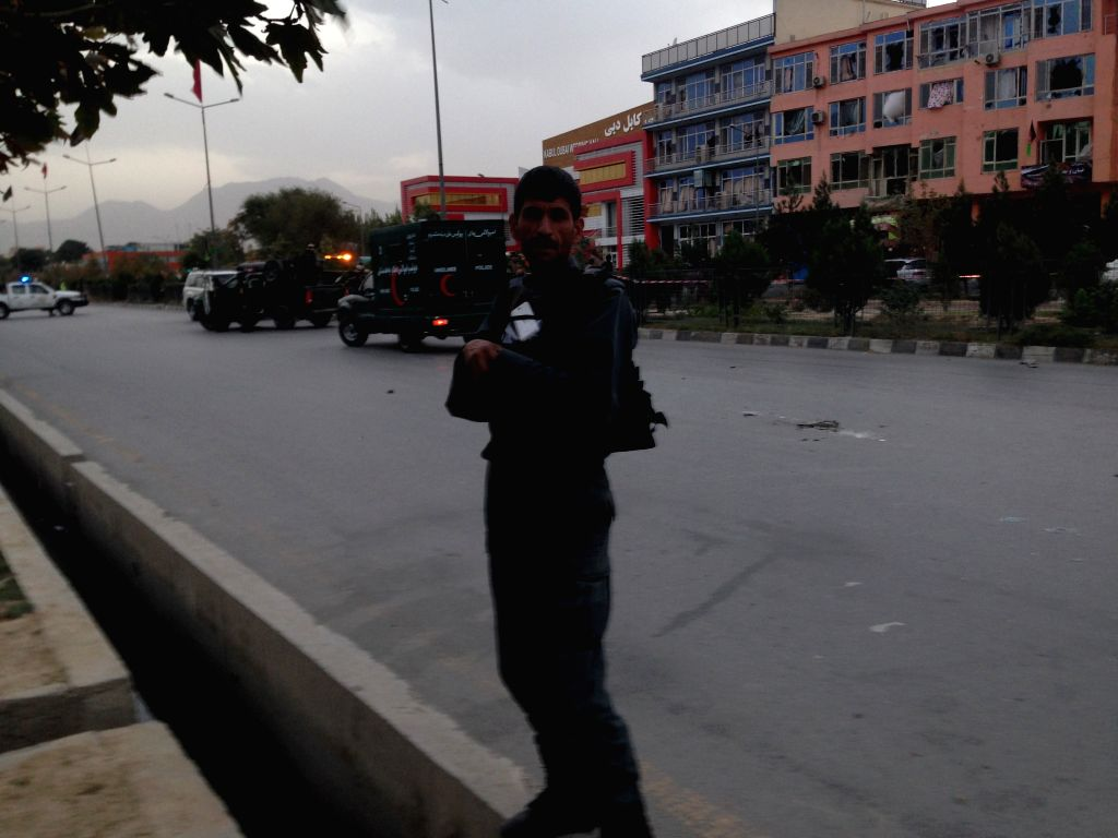 KABUL, Oct. 5, 2016 - A Policeman stands guard at the blast site on Darulaman Road in Kabul, capital of Afghanistan, Oct. 5, 2016. Six civilians sustained injuries as a suicide bomber targeted a bus ...