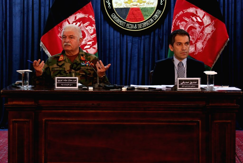 KABUL, Oct. 5, 2016 - Afghan Defense Ministry spokesman Dawlat Waziri (L) and Interior Ministry spokesman Sediq Sediqqi attend a joint press conference in Kabul, capital of Afghanistan, Oct. 4, 2016. ...