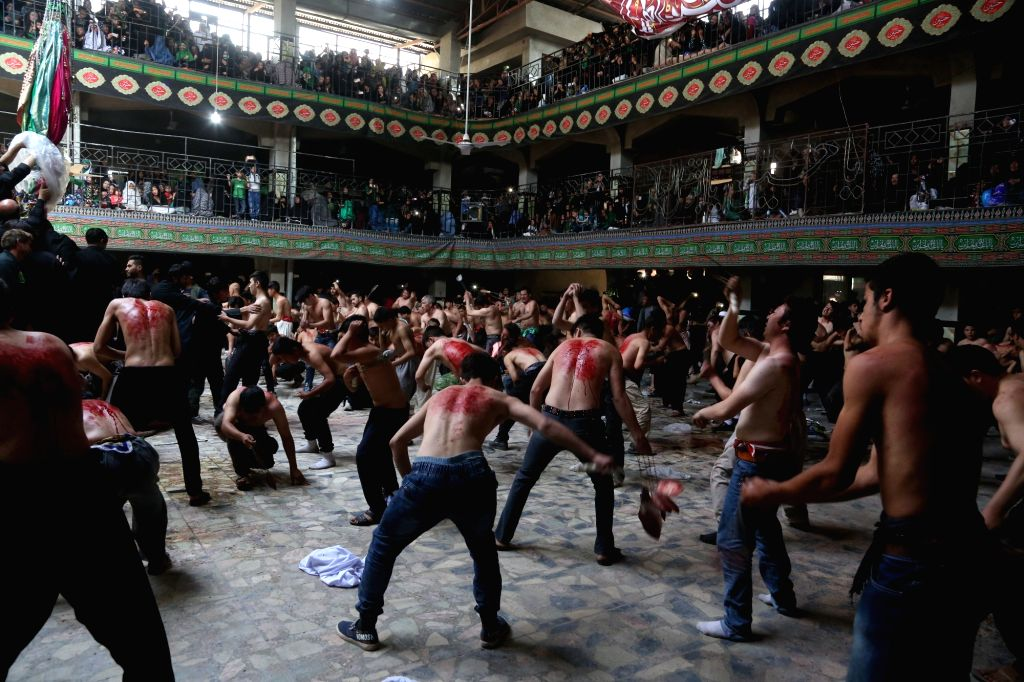 KABUL, Oct. 9, 2016 - Afghan mourners flagellate themselves ahead of Ashura at a mosque in Kabul, capital of Afghanistan, Oct. 9, 2016. Ashura, the 10th day of the Islamic month of Muharram, marks ...