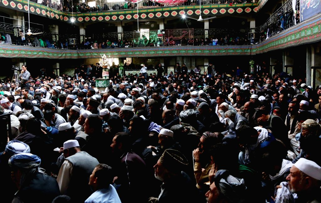 KABUL, Oct. 9, 2016 - Afghan mourners take part in a ceremony ahead of Ashura at a mosque in Kabul, capital of Afghanistan, Oct. 9, 2016. Ashura, the 10th day of the Islamic month of Muharram, marks ...
