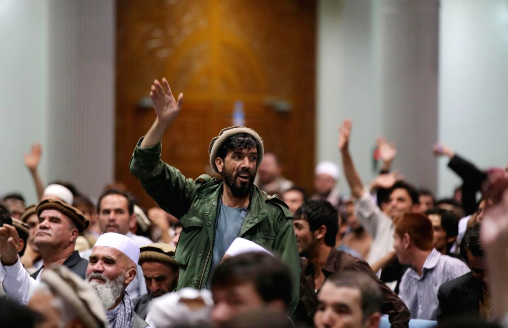 Afghan men shout slogans during a ceremony to mark the thirteenth anniversary of the assassination of late resistance leader Ahmad Shah Massoud in Kabul, ...