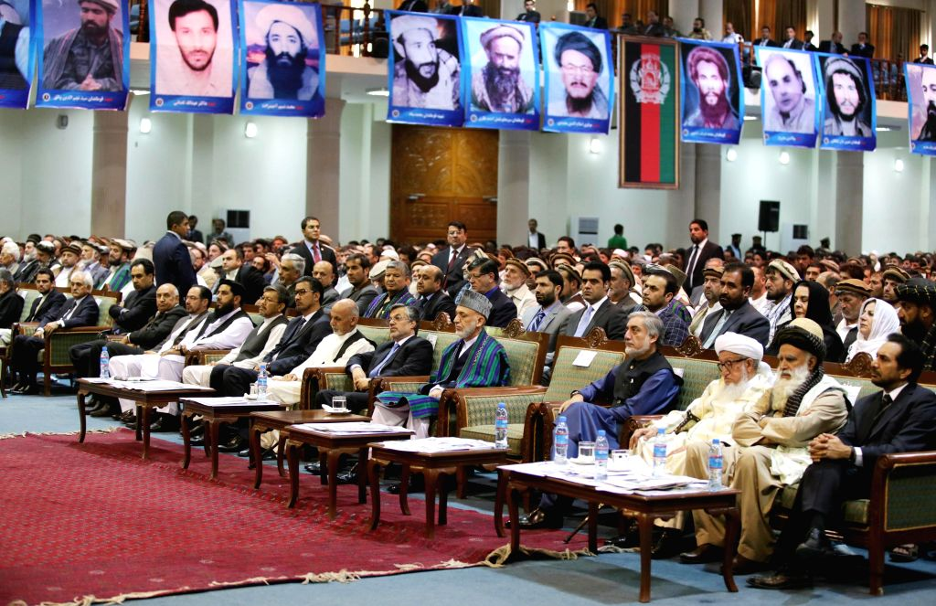 Afghan President Hamid Karzai (C) attends during a ceremony to mark the thirteenth anniversary of the assassination of late resistance leader Ahmad Shah Massoud in .