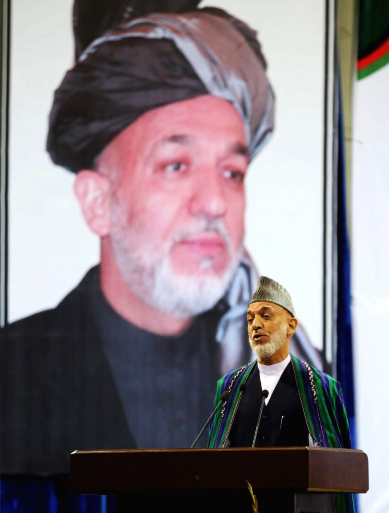Afghan President Hamid Karzai  speaks during a ceremony to mark the thirteenth anniversary of the assassination of late resistance leader Ahmad Shah Massoud in ...