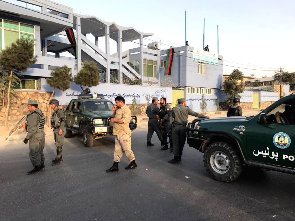 KABUL, Sept. 13, 2017 - Policemen cordon off the area around the site of the attack in Kabul, Afghanistan, Sept. 13, 2017. At least three people were killed and five others injured after a suicide ...