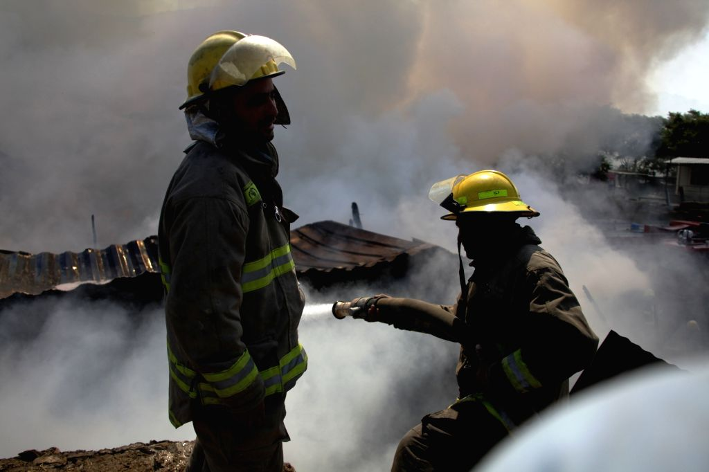 KABUL, Sept. 18, 2016 - Firefighters try to extinguish a fire at a market in Kabul, capital of Afghanistan, Sept. 18, 2016. Casualties feared as a market caught fire in Kabul, capital of Afghanistan, ...