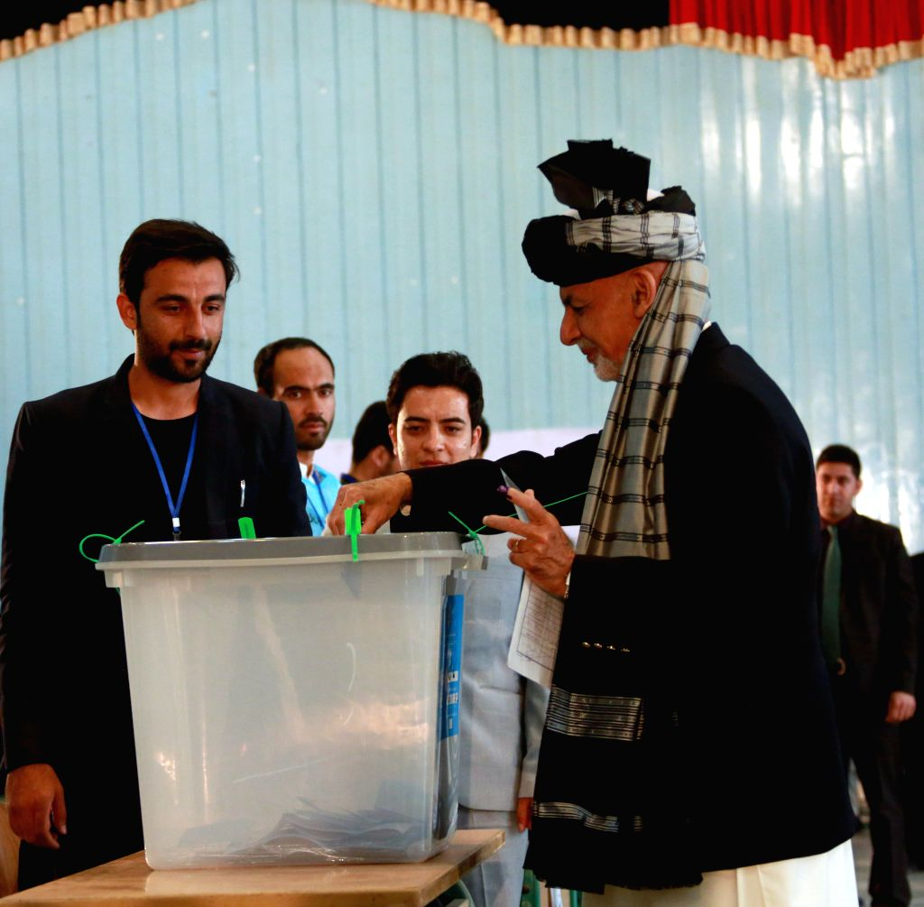 KABUL, Sept. 28, 2019 - Afghan President and presidential candidate Mohammad Ashraf Ghani (R) casts ballot at a polling center during presidential election in Kabul, capital of Afghanistan, Sept. 28, ...