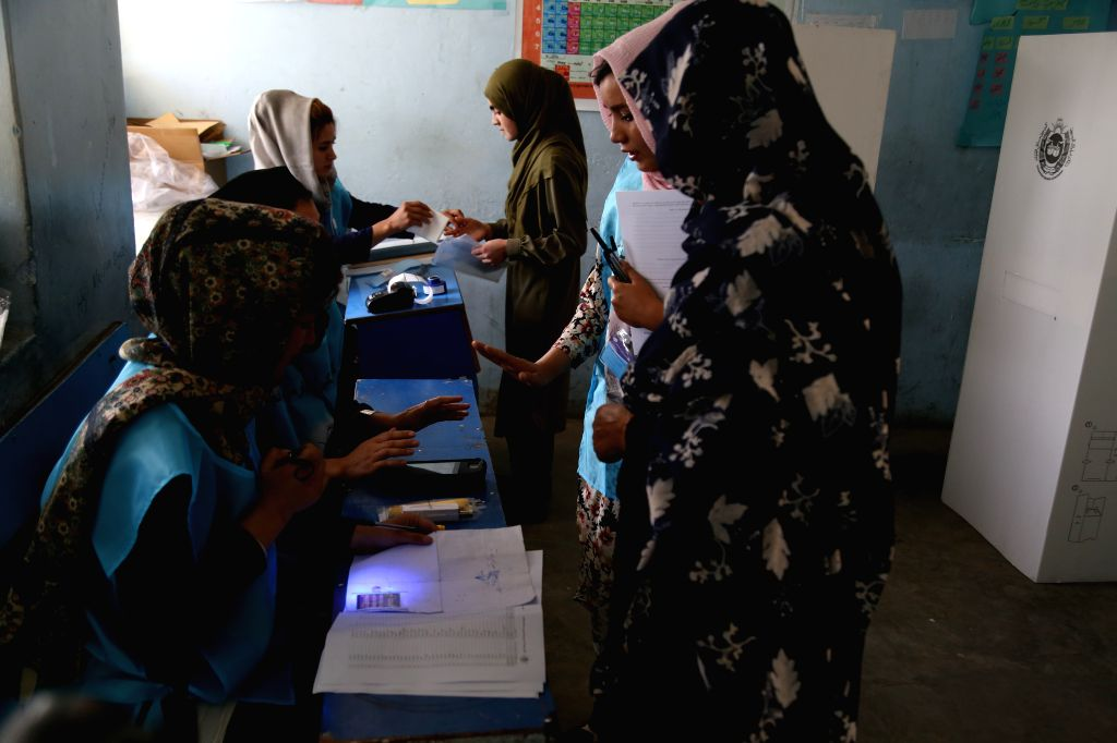 KABUL, Sept. 28, 2019 - Voters wait to cast their ballots at a polling center in Kabul, capital of Afghanistan, Sept. 28, 2019. Afghanistan held presidential election on Saturday.