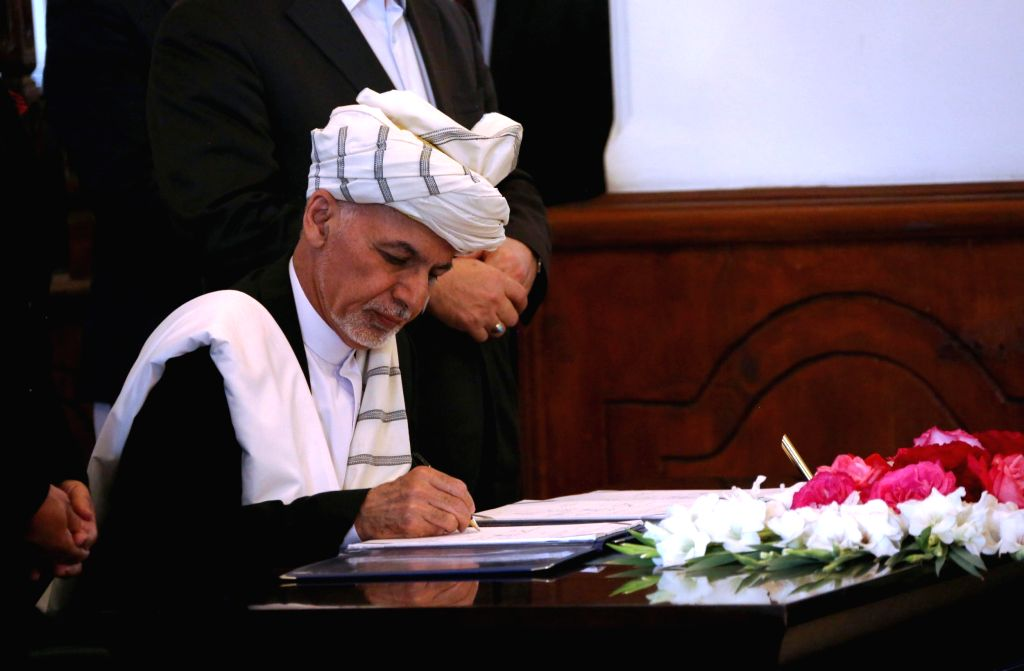 KABUL, Sept. 29, 2016 - Afghan President Mohammad Ashraf Ghani signs a peace deal in Kabul, capital of Afghanistan, Sept. 29, 2016. The Afghan government signed a peace deal with Hizb-e-Islami, a ...