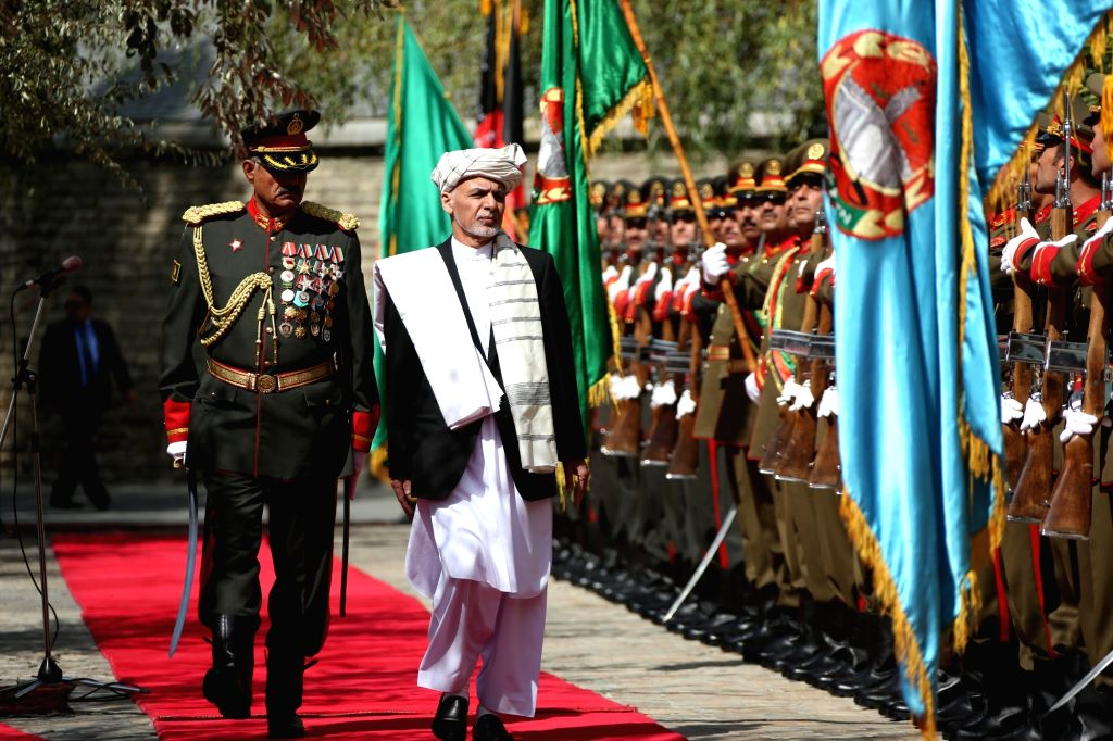 KABUL, Sept. 29, 2016 - Afghan President Mohammad Ashraf Ghani (R) inspects the honor guard during a signing ceremony of a peace deal in Kabul, capital of Afghanistan, Sept. 29, 2016. The Afghan ...