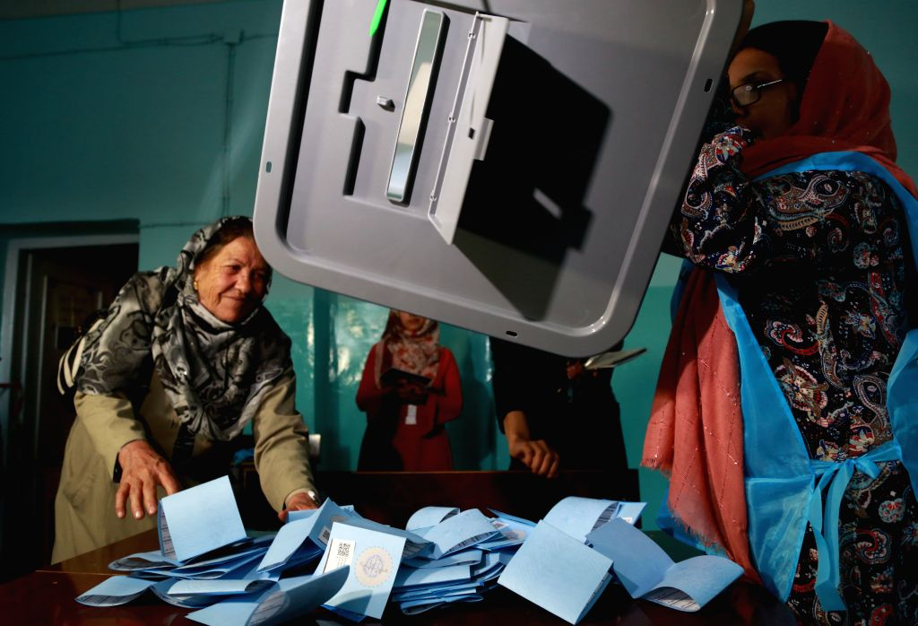 KABUL, Sept. 29, 2019 - An Afghan Independent Election Commission (IEC) worker prepares ballot papers for counting during presidential election at a polling center in Kabul, capital of Afghanistan, ...