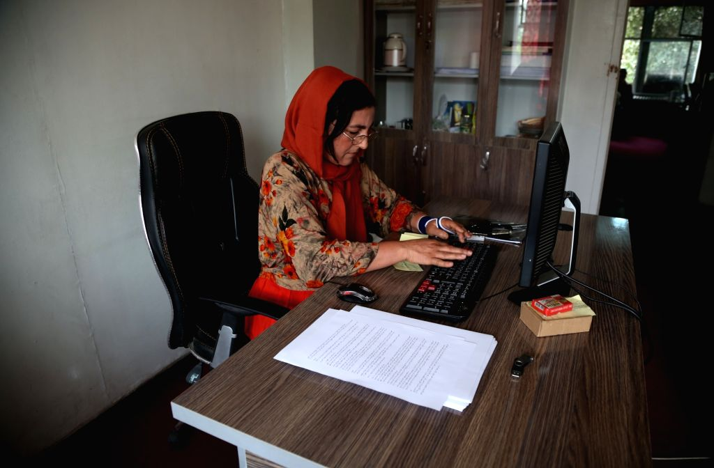 KABUL, Sept. 3, 2018 - Shukeria Kohistani, an Afghan female journalist of The Kabul Times, a daily government-run newspaper works at her office in Kabul, capital of Afghanistan, Sept. 3, 2018. ...