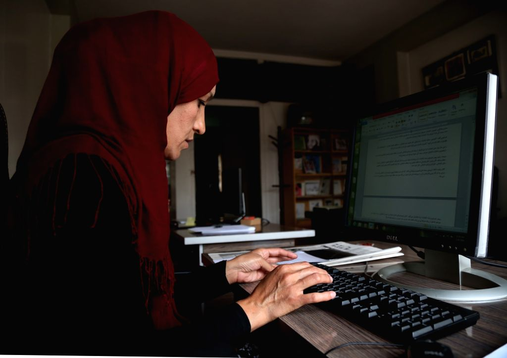 KABUL, Sept. 3, 2018 - Suraya Raiszadah, an Afghan female journalist of The Kabul Times, a daily government-run newspaper works at her office in Kabul, capital of Afghanistan, Sept. 3, 2018. Despite ...