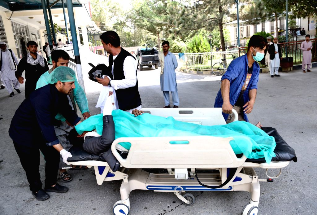 KABUL, Sept. 5, 2019 - A wounded person is sent to hospital after a car bomb attack in Kabul, capital of Afghanistan, Sept. 5, 2019. Over a dozen people were killed and injured as a car bomb blast ...