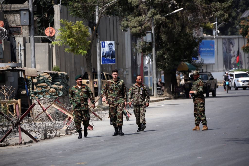 KABUL, Sept. 5, 2019 - Members of Afghan security forces stand guard at the site of a car bomb attack in Kabul, capital of Afghanistan, Sept. 5, 2019. At least 10 people, all civilians, have been ...