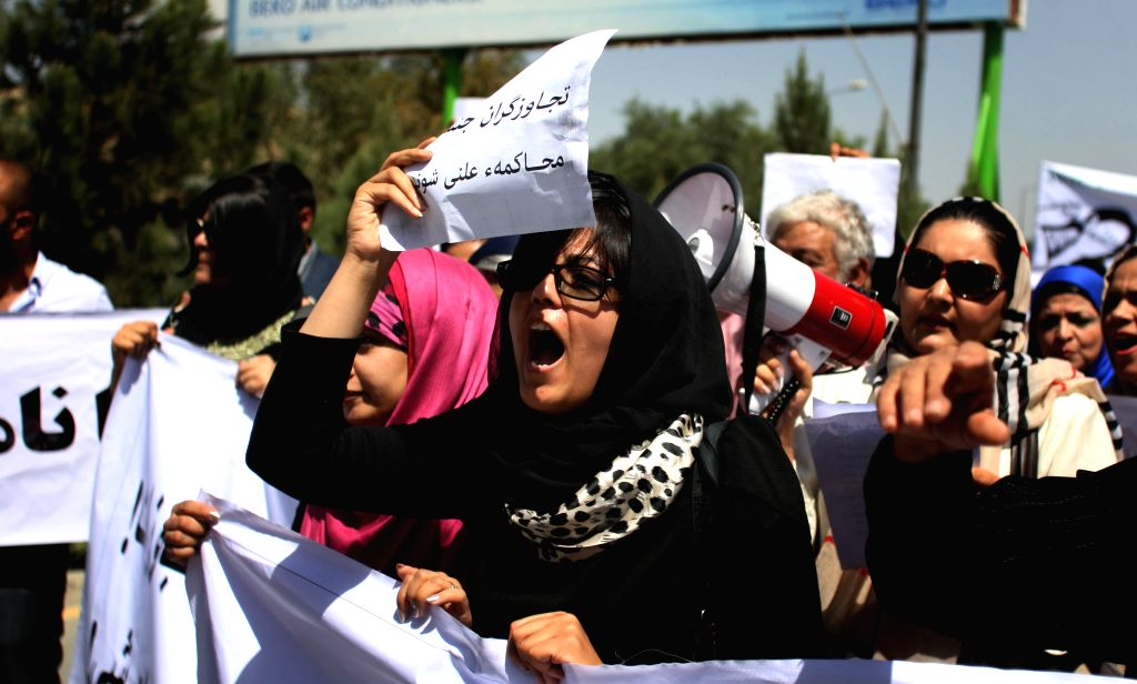 An Afghan protester shouts slogans against gang-rape on four women in front of Supreme Court in Kabul, Afghanistan, on Sept. 7, 2014. Hundreds of the Afghans attended