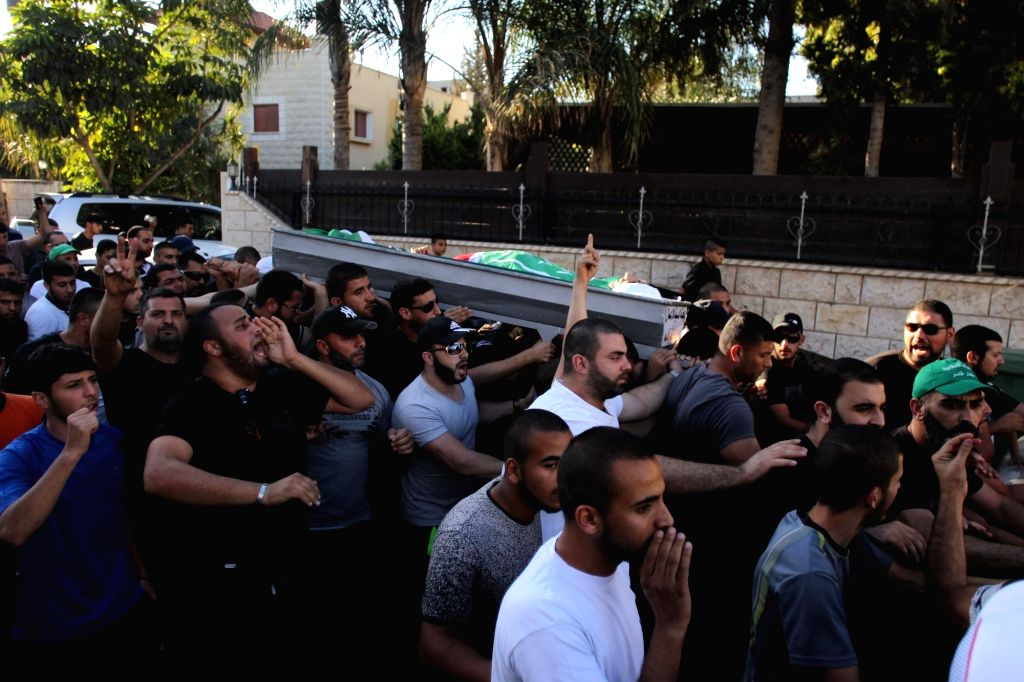 KAFR QASIM, June 6, 2017 - Mourners carry the body of Mahmoud Salim Taha during his funeral in the Arab town of Kafr Qasim in central Israel, on June 6, 2017. A security guard shot dead the Arab man ...