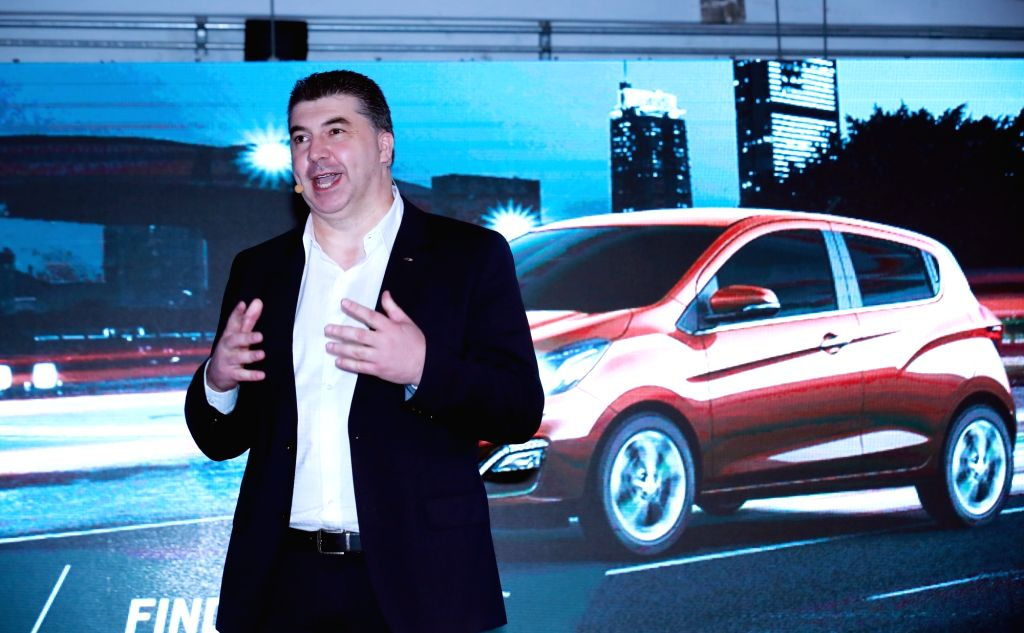 Kaher Kazem, chief executive of GM Korea Co., presents the company's upgraded Chevrolet Spark minicar at a media showcase in Seoul on May 23, 2018. The troubled automaker, the local unit of ...