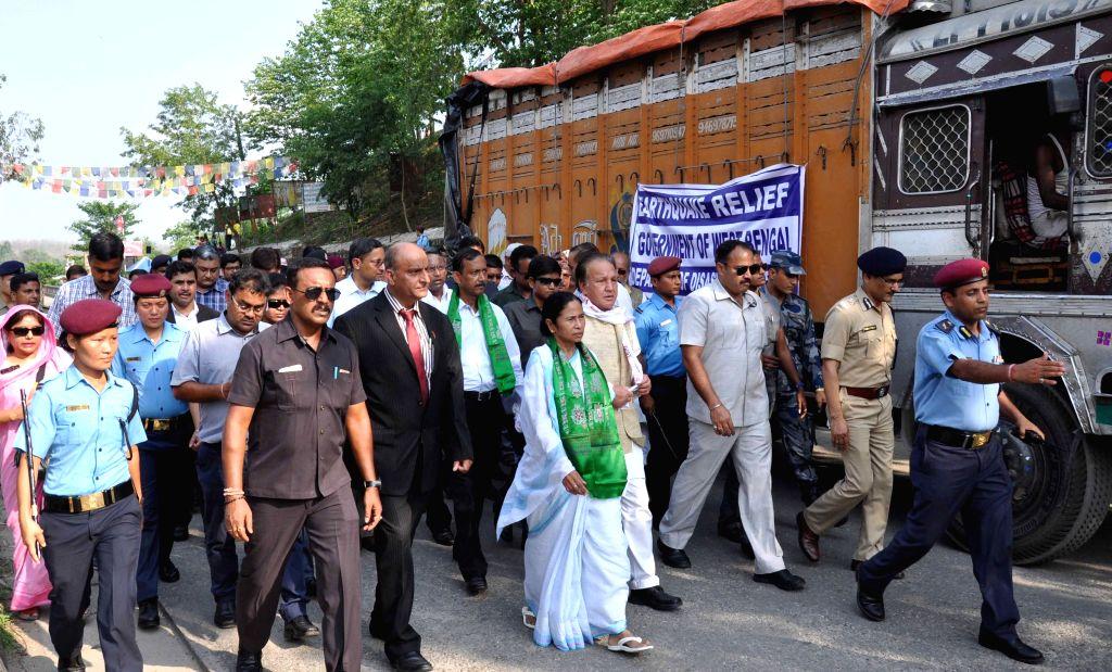 Kakarvitta (Nepal): West Bengal Chief Minister Mamata Banerjee visits earthquake hit Kakarvitta to distribute relief materials, in Nepal on May 4, 2015. - Mamata Banerjee