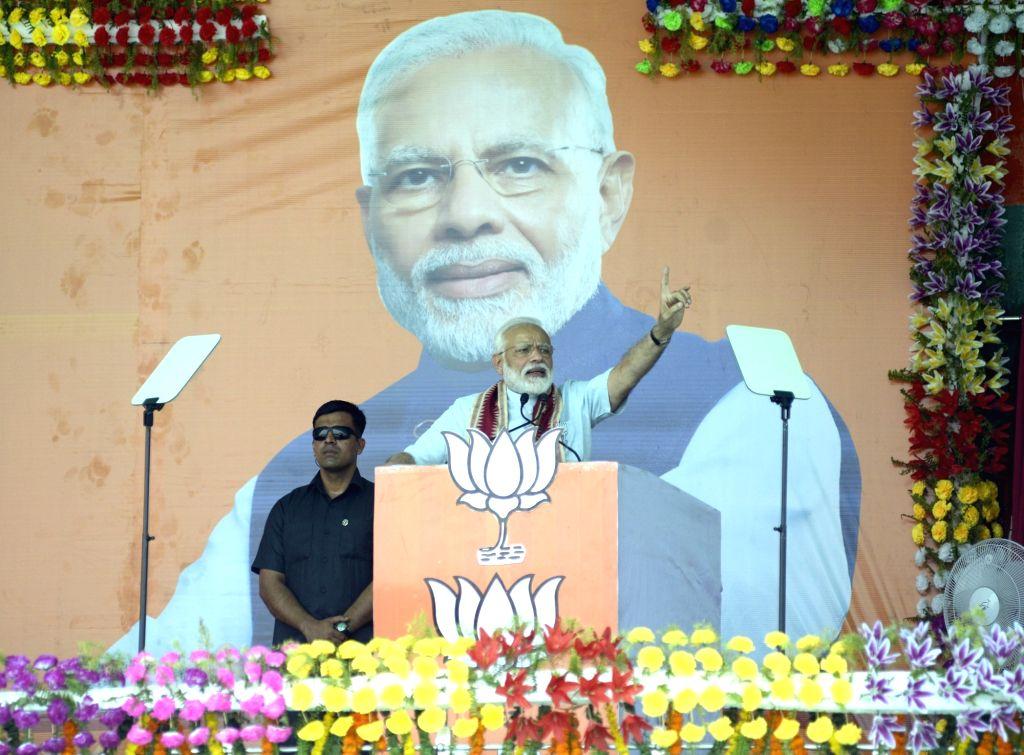 Kalahandi: Prime Minister and BJP leader Narendra Modi addresses during a public rally in Odisha's Kalahandi, on April 2, 2019. (Photo: IANS) - Narendra Modi
