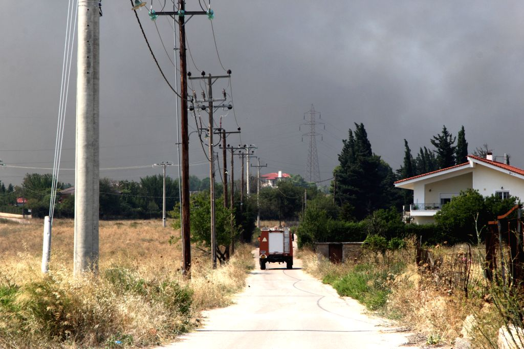 KALAMOS (GREECE), Aug. 15, 2017 A fire truck runs toward the site of forest fires near the village of Kalamos, north of Athens, Greece, on Aug. 15, 2017. Greece requested European civil ...