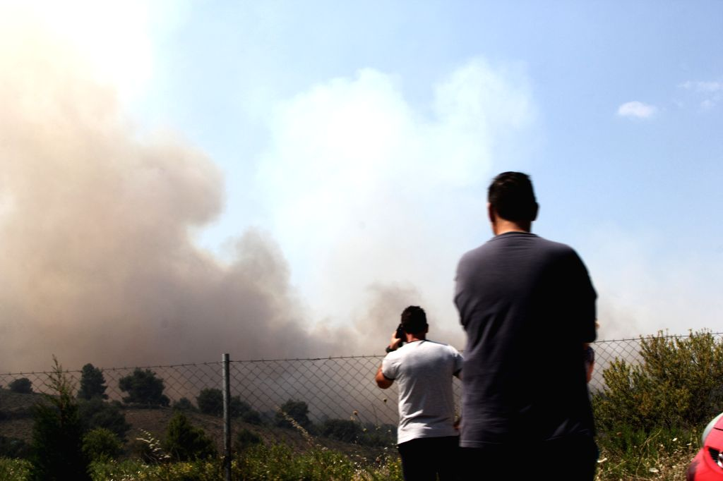 KALAMOS (GREECE), Aug. 15, 2017 Local people gather near the site of forest fires near the village of Kalamos, north of Athens, Greece, on Aug. 15, 2017. Greece requested European civil ...