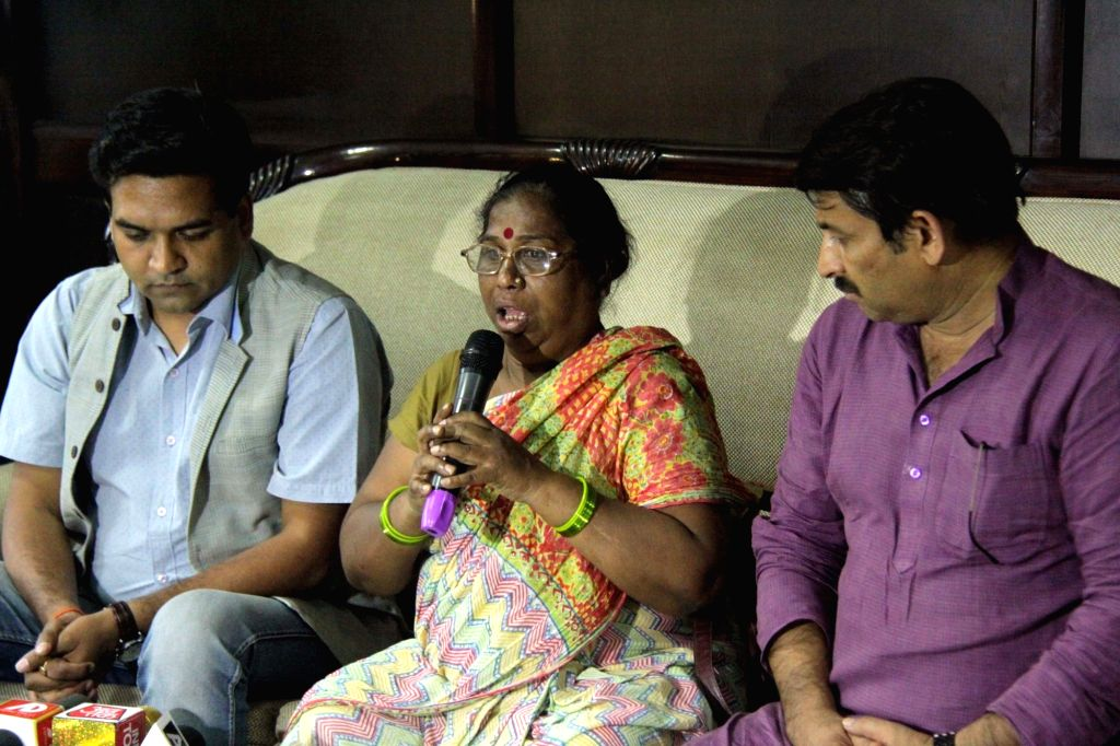 Kalavati, mother of AAP leader Santosh Koli who died in a road accident, addresses a press conference in the presence of Delhi BJP chief Manoj Tiwari and former AAP leader Kapil Mishra, in ... - Kapil Mishra