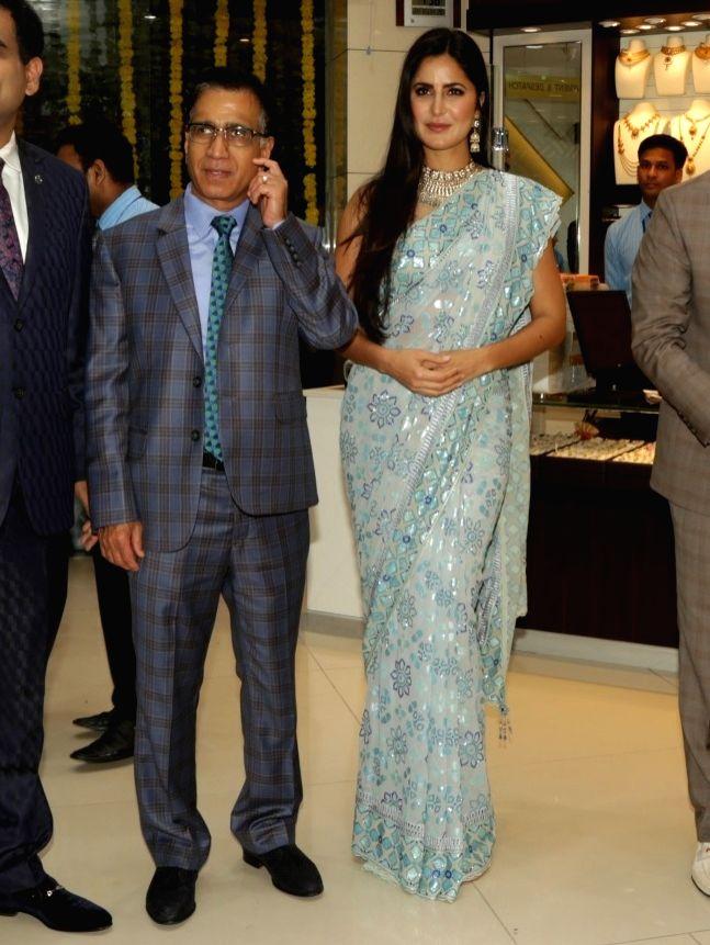 Kalyan Jewellers Chairman T S KAlyanaraman with Actress Katrina KAif at the launch of a jewellery store, in New Delhi, on July 22, 2018. - Katrina K