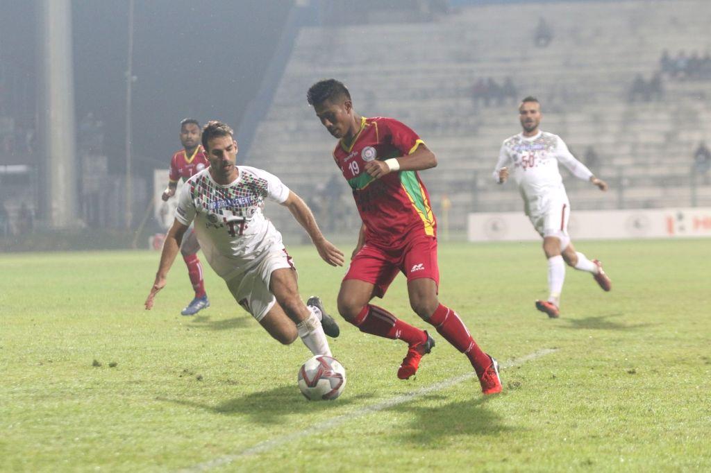 Kalyani: Players in action during a Hero I-League match between Mohun Bagan and league debutants Tiddim Road Athletic Union (TRAU) FC at the Kalyani Municipality Stadium in West Bengal's Kalyani on Dec 11, 2019. (Photo: IANS)