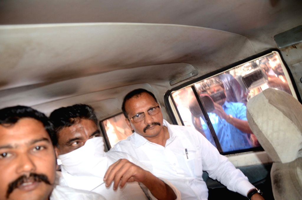 Kamala Mills owner Ramesh Govani being taken to be produced in court in connection with the December 29 fire in pubs that killed 14 persons; in Mumbai on Jan 23, 2018. Govani was detained and ...