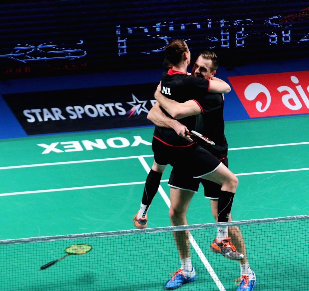 Kamilla Rytter Juhl and Vladimir Ivanov of Mumbai Rockets during a Premier Badminton League match against Delhi Acers' Akshay Dewalkar and Gabrielle Adcock  in New Delhi, on Jan 17, 2016. ...