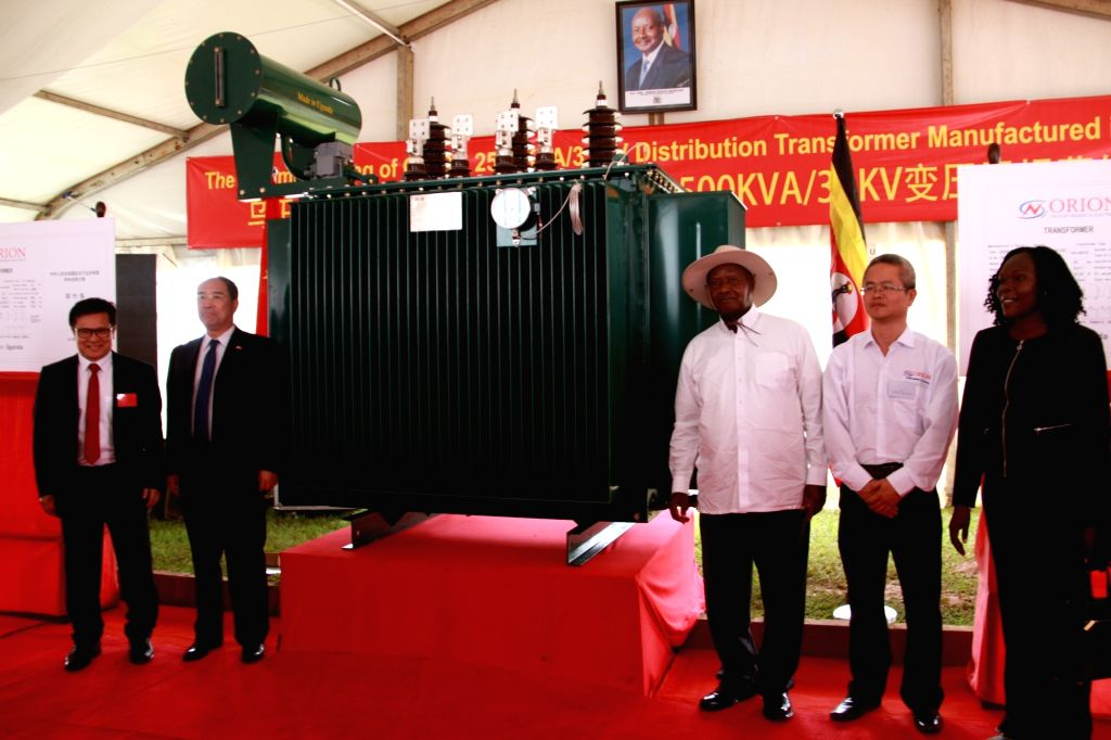 KAMPALA, Nov. 2, 2018 - Ugandan President Yoweri Museveni (3rd R) and Hou Jianxiong (1st L), chairman of Orion Transformers and Electrics Ltd, pose for a photo at the unveiling ceremony in Mukono ...