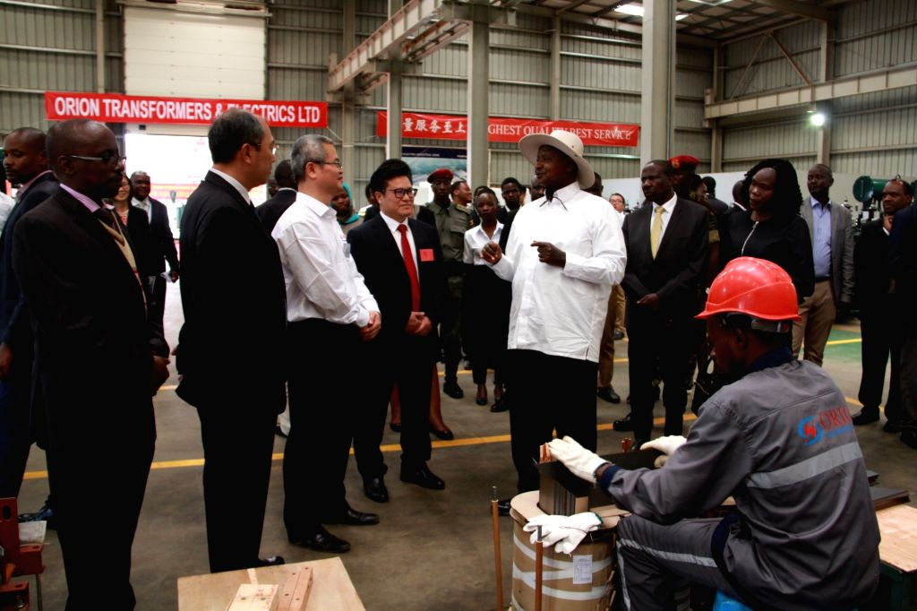 KAMPALA, Nov. 2, 2018 - Ugandan President Yoweri Museveni (R, center) visits the factory of the Orion Transformers and Electrics Ltd in Mukono district, Uganda, on Nov. 1, 2018. Ugandan President ...