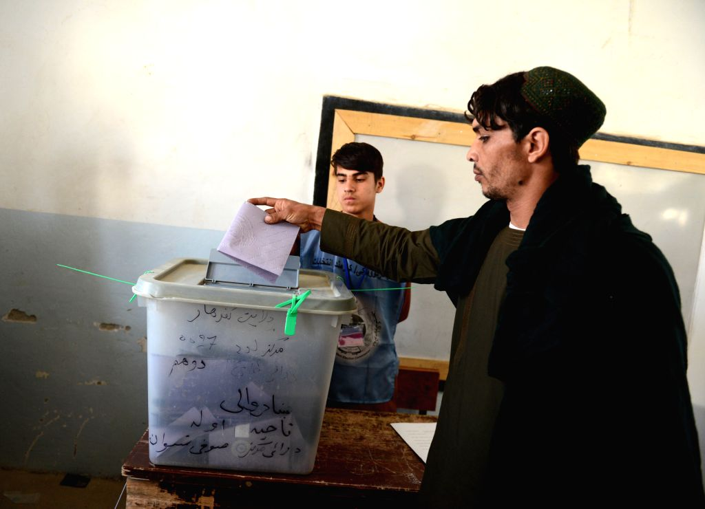 KANDAHAR (AFGHANISTAN), Oct. 27, 2018 (Xinhua) -- An Afghan voter casts his ballot at a polling station during parliamentary elections in Kandahar city, capital of Kandahar province, Afghanistan, on Oct. 27, 2018. People in Afghanistan's southern pro