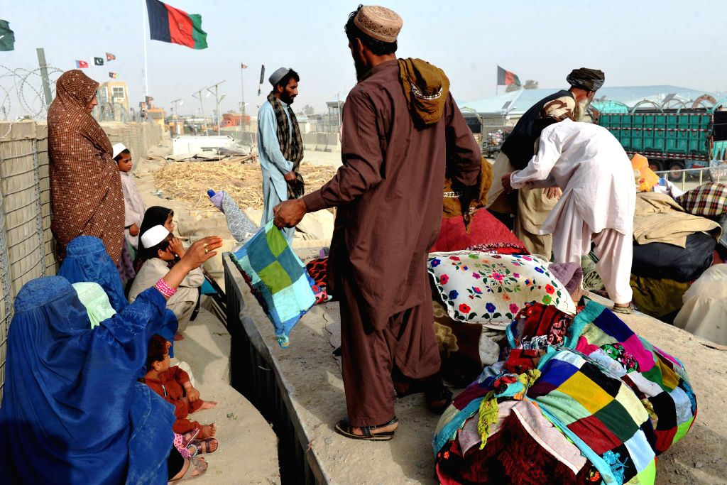 KANDAHAR, Aug. 2, 2016 - Afghans returning from Pakistan wait for the truck to take them home at the Spin Buldak border of southern Kandahar province, Afghanistan, Aug. 2, 2016. The United Nations ...