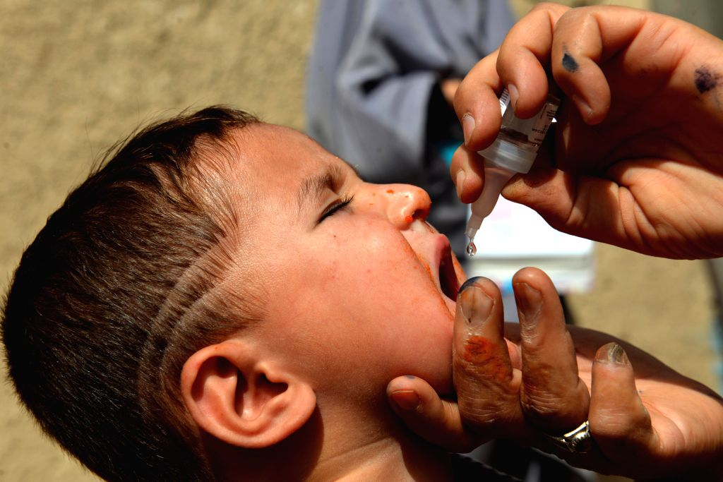 KANDAHAR, Aug. 7, 2018 - A health worker gives a polio vaccine to a child during a vaccination campaign in Kandahar city, Afghanistan, Aug. 7, 2018.