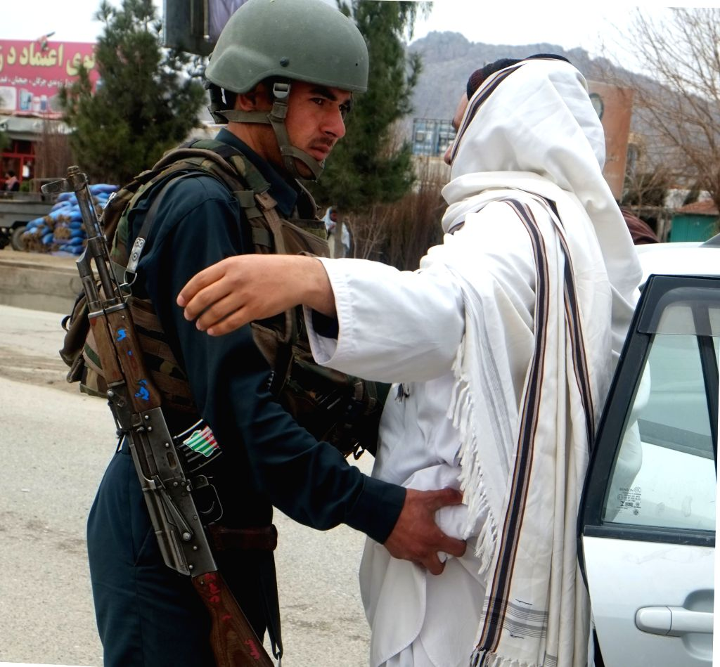KANDAHAR, Feb. 21, 2019 - An Afghan policeman frisks a man at a security checkpoint on the way leading to Panjwai district of Kandahar province, Afghanistan, Feb. 20, 2019 . The Afghan security ...