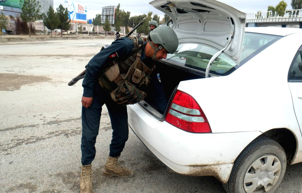 KANDAHAR, Feb. 21, 2019 - An Afghan policeman searches a vehicle at a security checkpoint on the way leading to Panjwai district of Kandahar province, Afghanistan, Feb. 20, 2019. The Afghan security ...