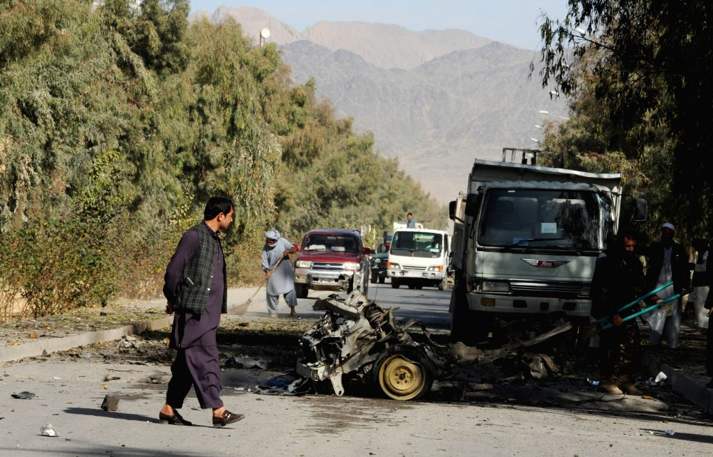 Afghan security forces inspect the site of suicide car bombing in Kandahar province, south Afghanistan,  Jan. 18, 2015. A suicide car bombing rocked Kandahar city,