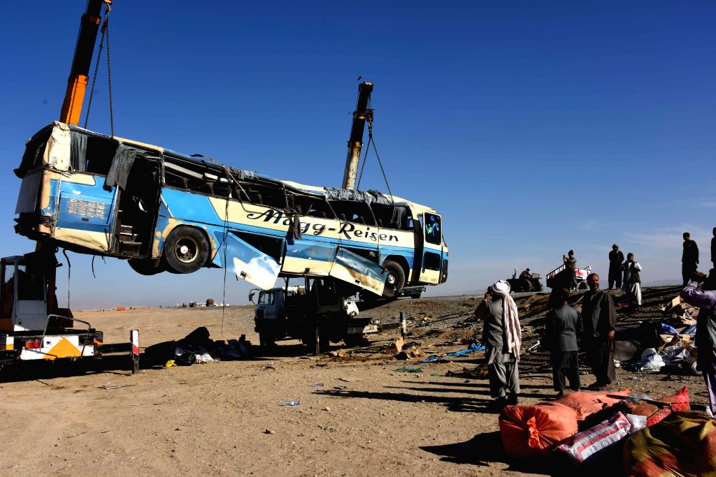KANDAHAR, Jan. 24 People gather near a damaged bus at the site of a traffic accident in Kandahar province, Afghanistan, Jan. 24, 2018. At least two commuters lost their lives and 21 ... - Allah Khan