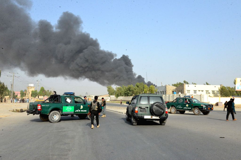 KANDAHAR, July 18, 2019 (Xinhua) -- Members of Afghan security forces stand guard at the site of the attack outside the provincial police headquarters in Kandahar, capital of Afghanistan's southern Kandahar province, July 18, 2019. At least 12 people