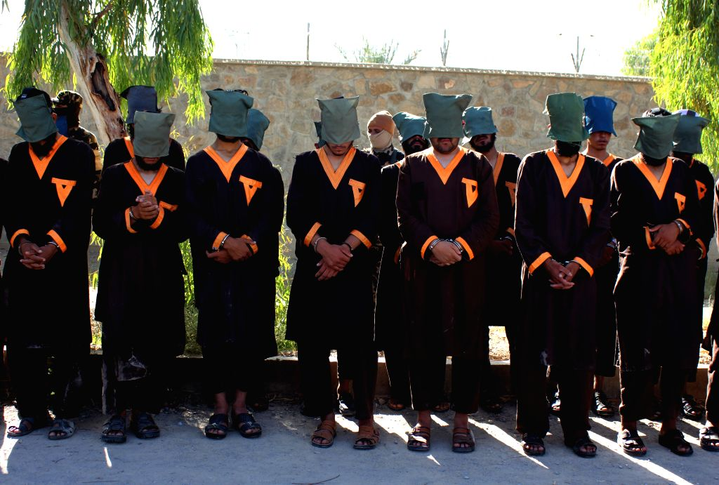 KANDAHAR, June 18, 2019 - Suspected militants stand handcuffed after being arrested in Kandahar province, southern Afghanistan, June 18, 2019. Afghan security forces have arrested 30 militants loyal ...