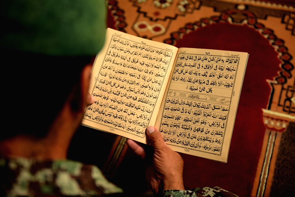 KANDAHAR, June 21, 2016 (Xinhua) -- A soldier reads Quran during the holy month of Ramadan in Kandahar province, southern Afghanistan, June 20, 2016. Muslims around the world celebrate Ramadan, the holy month in the Islamic calendar, during which the