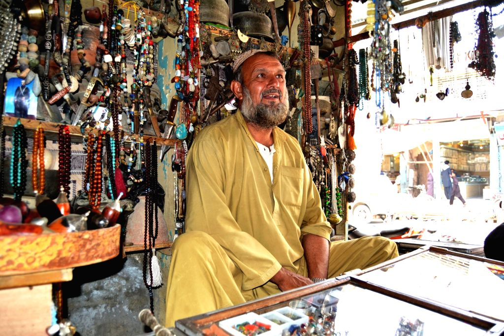 KANDAHAR, June 29, 2016 - An antique seller waits for customers at his shop in Kandahar province, southern Afghanistan, June 26, 2016.