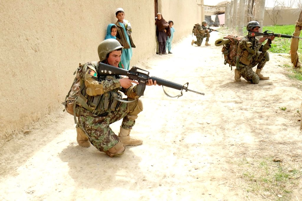 KANDAHAR, March 15, 2017 - Afghan army soldiers take positions during a military operation in southern Kandahar province of Afghanistan, on March, 14, 2017.