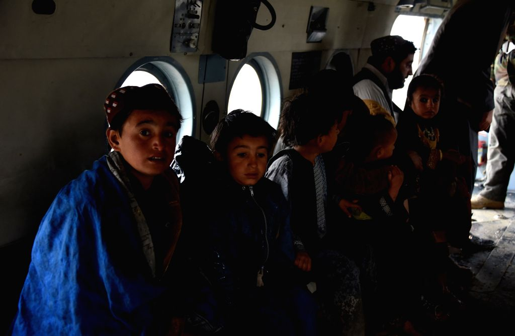 KANDAHAR, March 3, 2019 - A military helicopter carries local people during an evacuation operation after a flood in Kandahar province, Afghanistan, March 2, 2019 . At least 20 people were killed and ...