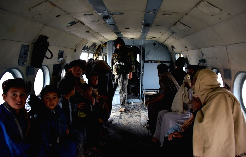 KANDAHAR, March 3, 2019 - A military helicopter carries local people during an evacuation operation after a flood in Kandahar province, Afghanistan, March 2, 2019 At least 20 people were killed and ...
