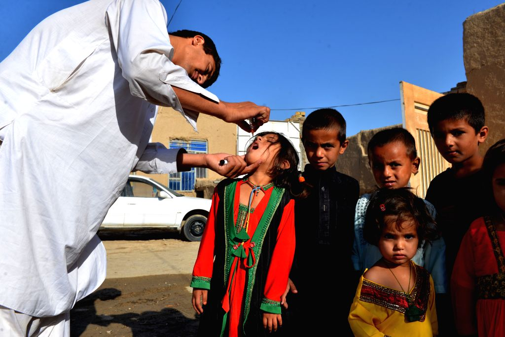 KANDAHAR, May 17, 2016 - An Afghan child receives a polio vaccine during an anti-polio campaign in Kandahar province, Afghanistan, May 16, 2016. An anti-polio campaign started in Kandahar province, ...