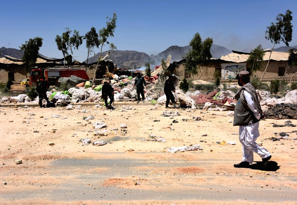 KANDAHAR, May 22, 2018 - Afghan security force members inspect the site of a blast in Kandahar province, Afghanistan, May 22, 2018. Seven people, including an assailant, were killed and 37 others ...