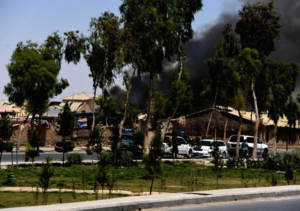 KANDAHAR, May 22, 2018 - Smoke rises from the the site of a blast in Kandahar province, Afghanistan, May 22, 2018. Seven people, including an assailant, were killed and 37 others wounded after a car ...